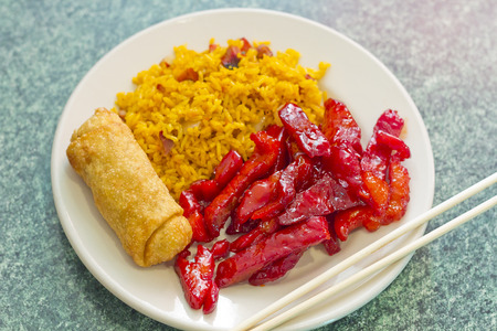 egg roll: Chinese boneless bbq spare ribs with egg roll and pork fried rice Stock Photo