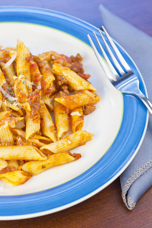 Penne pasta with ground beef meat sauce photo