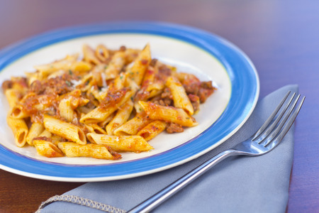 ground beef: Penne pasta with ground beef meat sauce