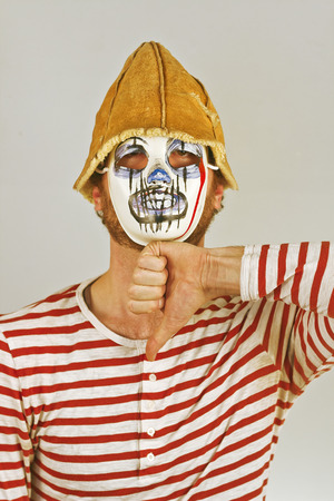 Weird scary masked mime in striped red and white shirt Imagens