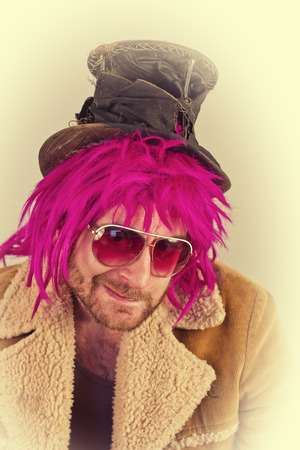 lunatic: Pink haired bearded bum lunatic man with cool sunglasses