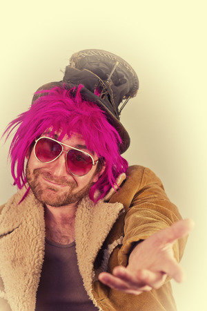 bum: Pink haired bearded bum lunatic man with cool sunglasses