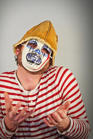 free vote: Weird scary masked mime in striped red and white shirt Stock Photo