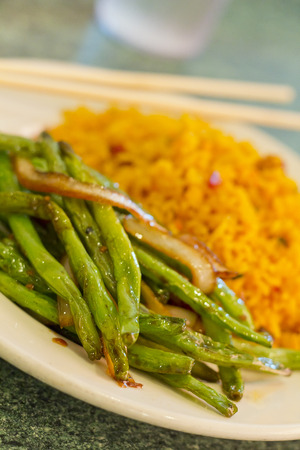 Chinese sauteed string beans in a brown oyster sauce with pork fried rice photo