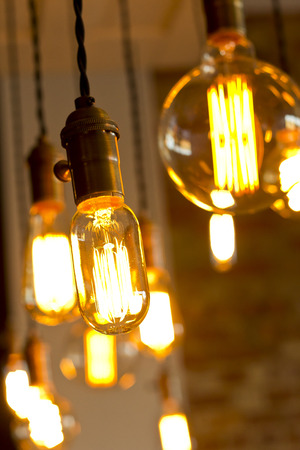 Decorative antique edison style light bulbs against brick wall background Stock Photo - 37347859
