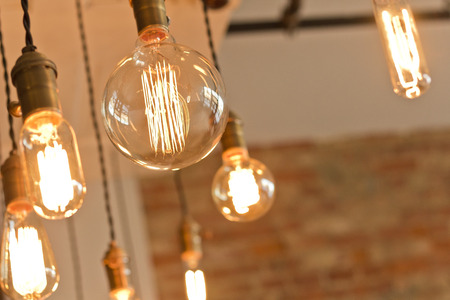 Decorative antique edison style light bulbs against brick wall background Stock Photo - 37347872
