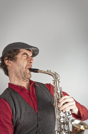 ugly man: Ugly man wails on saxophone while dressed as a beatnik