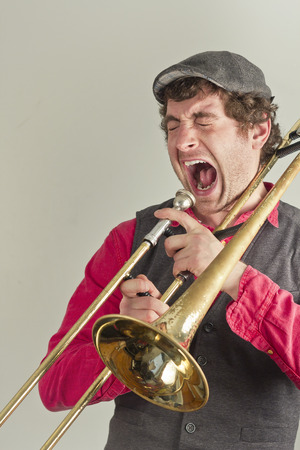 trombone: Jazz musician has had enough of his rusty trombone Stock Photo