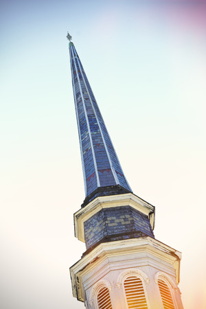 steeple: Old blue church steeple on a bright sunny day