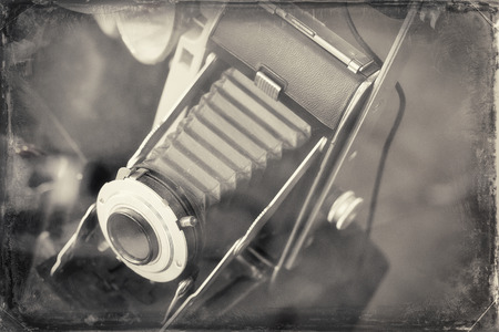 rectilinear: Antique accordion lens autographic fold-out camera from late 1910s to 1920s in photograph style inspired by this cameras era