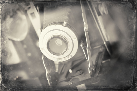 Antique accordion lens autographic fold-out camera from late 1910's to 1920's in photograph style inspired by this cameras era
