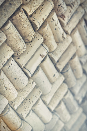 corked: Wine corks arranged in checkered pattern for wine or restaurant background