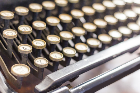 old desk: Old vintage typewriter keys in this retro creative writing and relaxation themed desk top Stock Photo