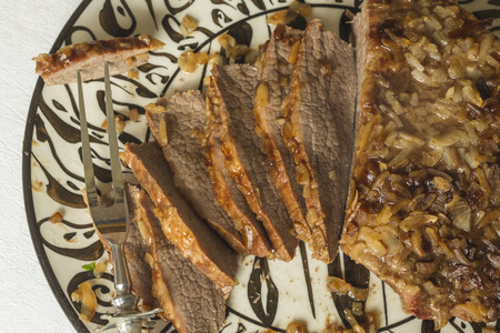 sweet and savoury: Jewish Passover brisket with savory walnut breading sliced and ready to serve Stock Photo