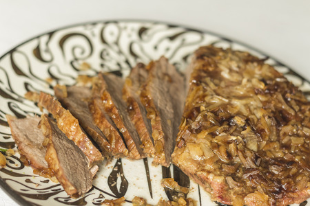 breading: Jewish Passover brisket with savory walnut breading sliced and ready to serve Stock Photo