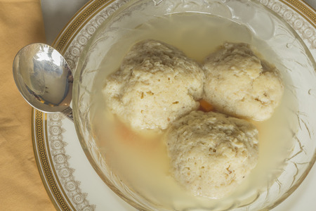 matzo balls: Traditional passover matzoh ball soup with unleavened bread and wine