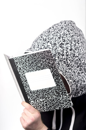 cramming: College student studies notes from marble notebook