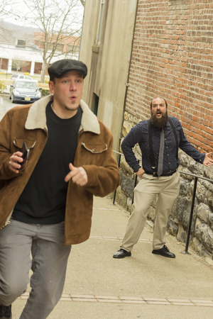 hoodlum: Hoodlum steals wallet from balding bearded business man Stock Photo