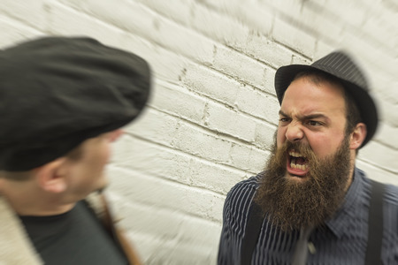 passerby: Crazy angry bearded man yells in the face of a passerby Stock Photo