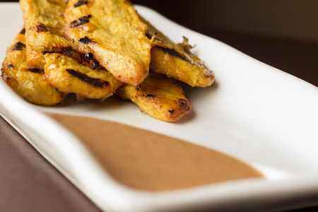 peanut sauce: Thai chicken satay skewers with spicy peanut sauce for dipping Stock Photo