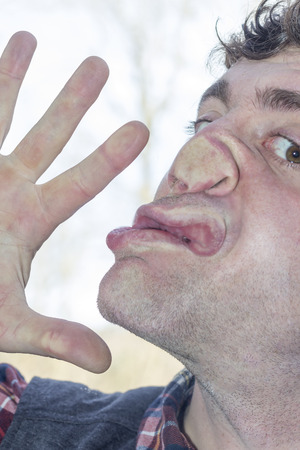 lunatic: Crazy lunatic man smooshes face against glass surfaces