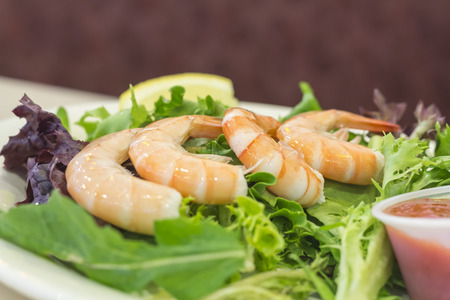 lemon wedge: Shrimp cocktail salad with legs on shrimp and lemon wedge Stock Photo