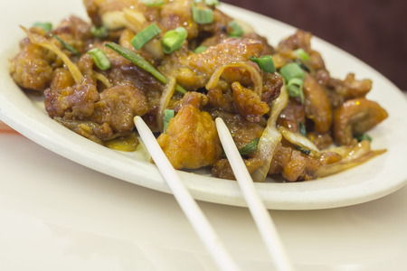 Dining out restaurant Teriyaki chicken with fresh scallions glistens with delicious perfection Stock Photo