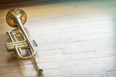 forlorn: The joyful noise of this old trumpet rings through the halls like a ghost of forgotten memories Stock Photo