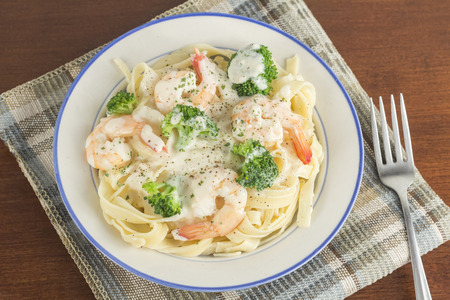 Italian health conscious fettuccine alfredo shrimp with broccoli florets