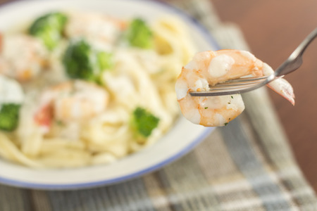 alfredo: Italian health conscious fettuccine alfredo shrimp with broccoli florets
