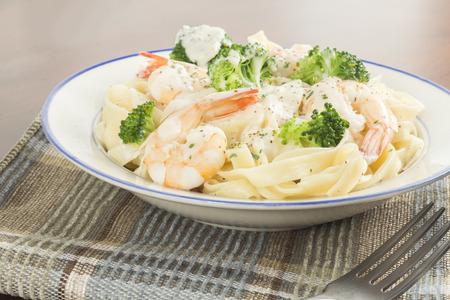 health conscious: Italian health conscious fettuccine alfredo shrimp with broccoli florets