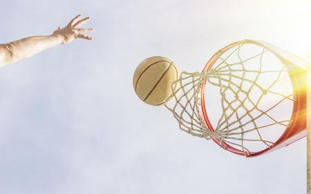 layup: Basketball layup shot scene from just below the net Stock Photo