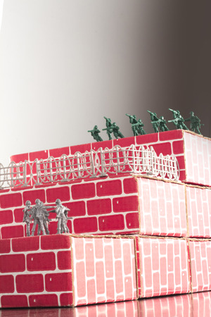 odds: Gray toy army men up against impossible odds in uphill battle