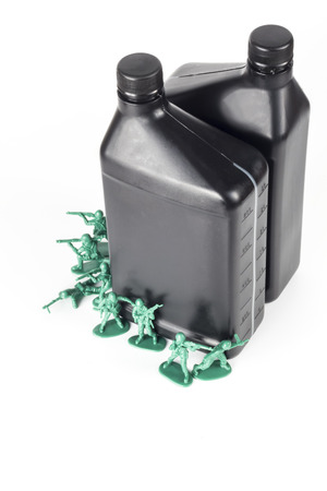 green plastic soldiers: Toy army men with quart of oil symbolizing oil war in Middle East Stock Photo