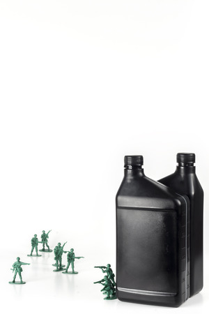 middle east war: Toy army men with quart of oil symbolizing oil war in Middle East Stock Photo