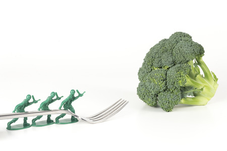 army soldier: Army Men carry fork to broccoli in childrens healthy eating image