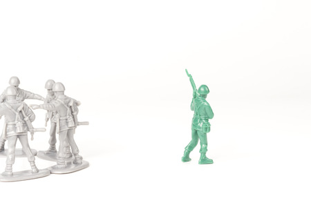 green military miniature: Gray toy soldiers excluding the green toy soldier