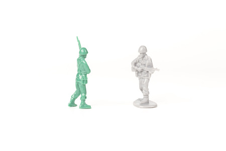 sibling rivalry: Two different toy army men cross paths