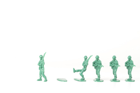 Green army leader steps off his foot stand and others follow Stock Photo
