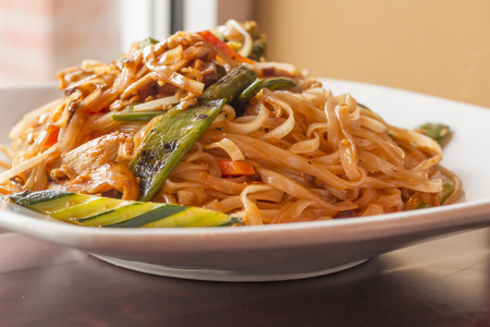 snap bean: Authentic spicy Pad Thai with chicken served with Asian vegetables