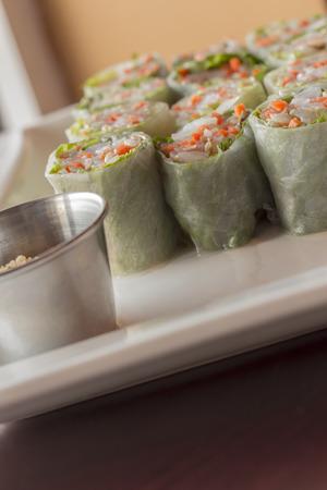 peanut sauce: Fresh sliced vietnamese vegetable spring rolls with shrimp and sweet peanut sauce Stock Photo