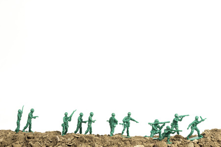 Toy soldiers march along the horizon in war image Archivio Fotografico