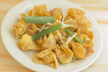 chinese dinner: Chinese cheese wontons appetizer at restaurant served with green onion and bean sprouts