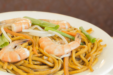 mee pok: Authentic Chinese Shrimp lo mein noodles at a restaurant Stock Photo