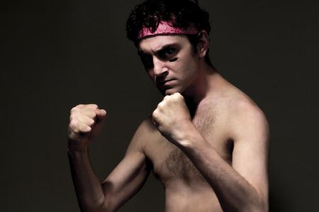 jiu jitsu: Very skinny headband wearing fighter shows skills Stock Photo