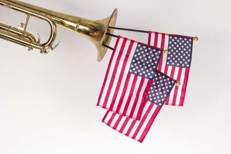 triumphant: Three American Flags erupt from the bell of a trumpet in patriotism image Stock Photo
