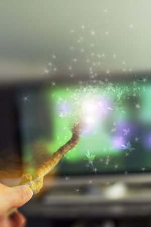 Changing the television with magic wand for fantasy shot with selective focus