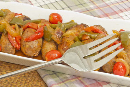 Hot grilled italian sausage with sliced peppers and onions