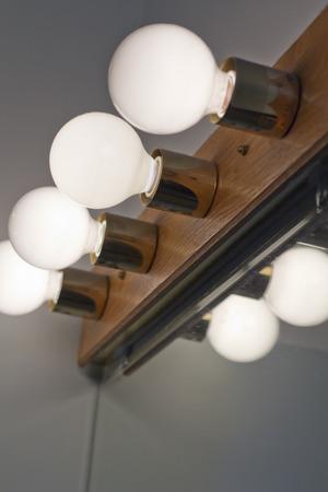 Stock Photo   White Candelabra Globe Bathroom Bulbs Above Mirror