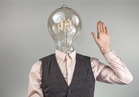 Lighbulb head businessman for imagination themed background image
